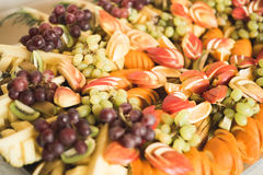 Various sweet sliced fruit on a buffet table Royalty Free Stock Image