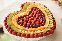 Various sweet sliced fruit on a buffet table Stock Photo