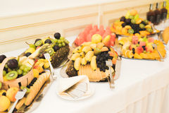 Various sweet sliced fruit on a buffet table Royalty Free Stock Photography