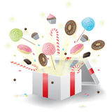 Sweets burst from present box Royalty Free Stock Photos