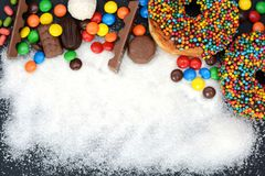 Various sweets and sugar powder as background Royalty Free Stock Photography