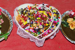 Various sweets in the wedding basket on a red background. Holiday Engagement - hina. Stock Photography