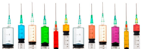 Various syringes filled with colored liquids Stock Photos