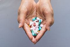Various tablets pills in hand Royalty Free Stock Image