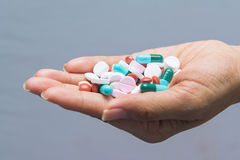 Various tablets pills in hand Stock Photography