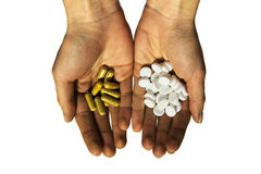 Various tablets stretched in hands. Two various kinds of tablets of the girl, stretched in hands Stock Photography