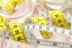 Various tape measure. As background Royalty Free Stock Images