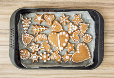 Various tasty gingerbread cookies on the tray, Christmas theme Stock Photos