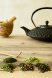 Various tea sorts from Japan. Green tea sorts from Japan with black teapot and bamboo whisk Stock Photo