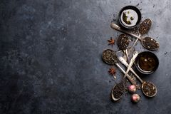 Various tea in spoons. Black, green and red tea royalty free stock photo