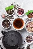 Various tea and teapot. Black, green and red tea stock image