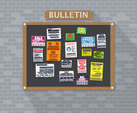 Various tear off papers ad on bulletin board Royalty Free Stock Photography