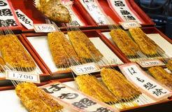 Various teriyaki fish skewers on sale Stock Photos