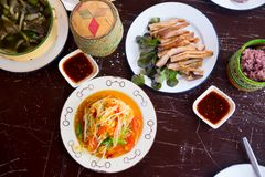 Various of Thai spicy food on rustic background. Top view. Asian food concept stock photo