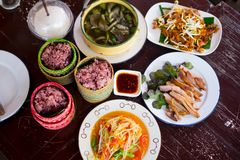 Various of Thai spicy food on rustic background. Top view. Asian food concept stock photography
