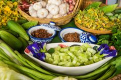 Various thai vegetables, spices and chilli sauce. Various Thai vegetables, spices  and chilli sauce in basket, ready for cooking, selectively focus Stock Photos