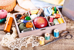 Various threads and sewing tools in box Stock Photography