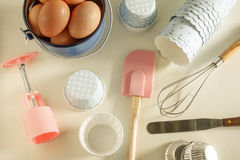 Various tins and paper cases for tartlets and muffins. Stock Photo