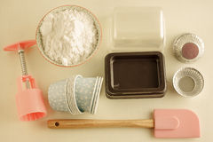 Various tins and paper cases for tartlets and muffins. Stock Images