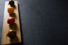 Various tomatoes arrange in wooden tray Royalty Free Stock Image