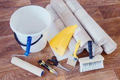 Various tools for home repair and rolls of wallpaper Royalty Free Stock Images