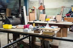 Various tools and supplies at carpentry workshop. Stock Images