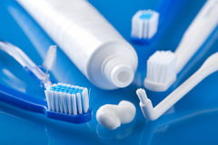 Various toothbrushes and paste Stock Photos