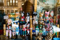 Various toy animals, sitting in a window display, holding fishing rods royalty free stock photography