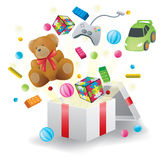 Toys burst from present box in white background Stock Images