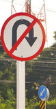 Various traffic signs beside country road Royalty Free Stock Photos