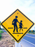 Various traffic signs beside country road Royalty Free Stock Photography