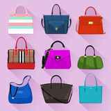 Various trendy women bags with colorful prints. Flat style. Royalty Free Stock Photo