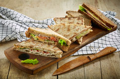 Various triangle sandwiches on wooden board Royalty Free Stock Photo