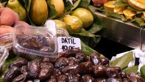 Various tropical fruits mango kiwi peaches dates on food market counter. Various tropical fruits mango kiwi peaches dates on the food market counter stock video footage