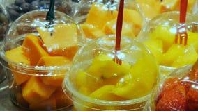 Various tropical fruits mango kiwi peaches dates on food market counter. Various tropical fruits mango kiwi peaches dates on the food market counter stock footage