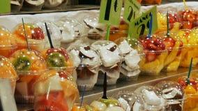Various tropical fruits mango kiwi peaches dates on food market counter. Various tropical fruits mango kiwi peaches dates on the food market counter stock video