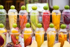 Various tropical fruits prepared in cups for making mixed fruit stock photos