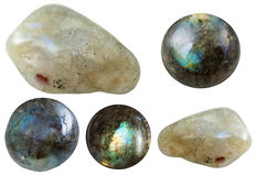 Various tumbled and cabochon labradorite gemstones. Macro shooting of collection natural stones - various tumbled and cabochon labradorite gem stones isolated on Stock Photos