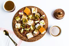 Various Turkish delights on a copper plate isolated stock photos