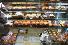 Various type of cakes in shop window in Italy Royalty Free Stock Images