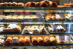 Various type of cakes in shop window in Italy Royalty Free Stock Image