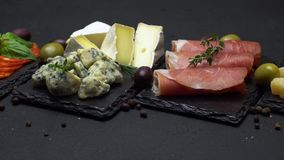 Various type of italian meal or snack - cheese, sausage, olives and parma stock video