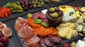 Various type of Italian meal or snack - cheese, sausage, olives and parma. Various type of traditional Italian meal or snack - cheese, sausage, olives and parma stock video footage