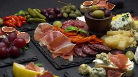 Various type of italian meal or snack - cheese, sausage, olives and parma. Various type of traditional italian meal or snack - cheese, sausage, olives and parma stock footage
