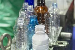 The various type of PET bottle sample parts. The plastic bottle container show in the shelf stock image