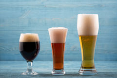 Various types of beer. On a wooden background royalty free stock photo