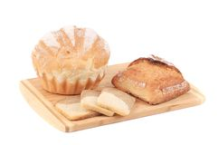 Various types of bread on cutting board. Stock Image