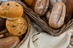 Various types of bread in wicker basket Royalty Free Stock Photo