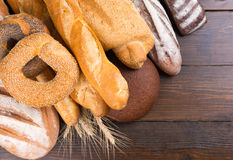Various types of bread on wood table Royalty Free Stock Photos