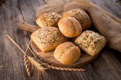 Various types of bread. On wooden background Stock Photo
